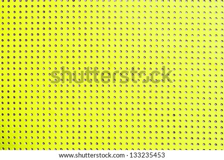 Vintage yellow beige background with grunge polka dots seamless pattern