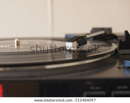 Vinyl record spinning on a turntable, focus on needle