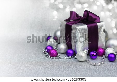 Violet Christmas gift with decoration