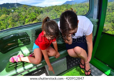 Visitors travel on Cableway above the Barron Gorge National Park a World Heritage in the Wet Tropics of Queensland, Australia.