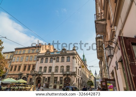 VIV, UKRAINE - OCTOBER 03, 2015 : The area the market, a central square in Lviv. Beautiful, old streets of Lviv.
