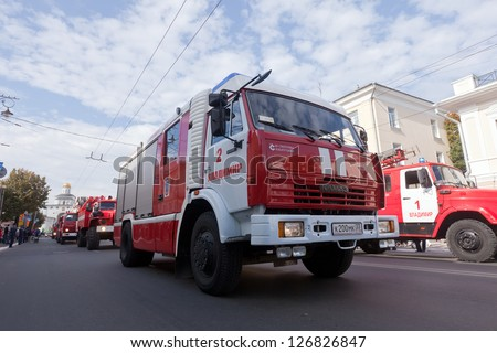 VLADIMIR, RUSSIA - SEPTEMBER 15: City Day  event September 15, 2012 in Vladimir, Russia.  Fire trucks in carnival procession  dedicated to the 1022 anniversary of Vladimir city