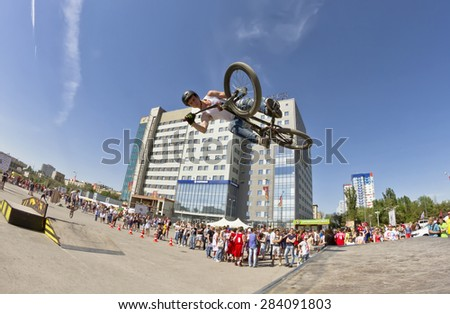 VOLGOGRAD - MAY 24: The BMX cyclist performs a stunt jump. The fifth annual competition for the Cup of Europe city Mall . May 24, 2015 in Volgograd, Russia.