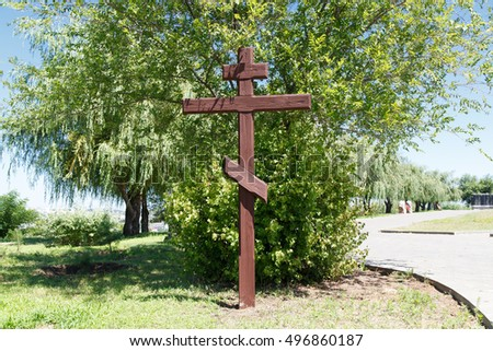 VOLGOGRAD, RUSSIA - July 6, 2016: A wooden cross at the military, soldier's cemetery the dead during World War II (Great Patriotic War) of war in days of the battle of Stalingrad, Mamayev Kurgan