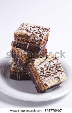 Wafer Cake with chocolate and condensed milk on white background