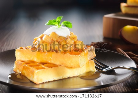 waffles with diced apple cooked, cinnamon, caramel syrup and yogurt topping