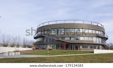 WAGENINGEN, NETHERLANDS - FEBRUARY,24 2014: Round high school building near the Wageningen Univeristy and Research Campus  in Wageningen..