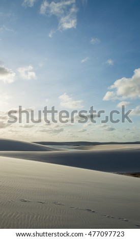 Walking on white dune and clouds.