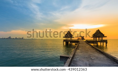 Walking path leading to Temple in the sea skyline sunset background