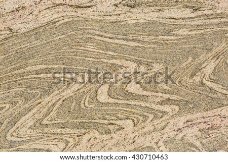 Wall of marble with stone layers of different colors of wave shape. Close up macro photography. Creative wallpaper photography.