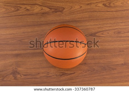 wall of room with a basketball on wooden floor
