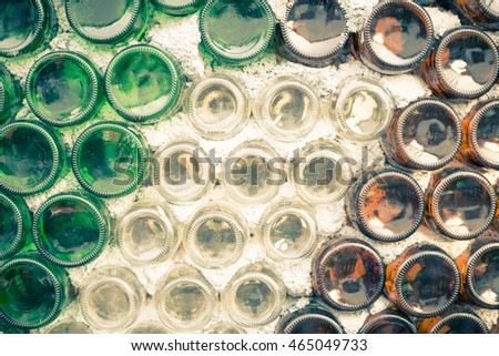 Wall of warehouse with many bottles Selective focus. form dust old cork bar row pile line rack wet vine ripe noir shot beer indoors green factory dark winery wheat light concrete malt blur stack round