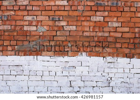 Wall texture with red on the top  and white in the bottom bricks