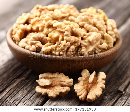Walnuts in a wooden plate