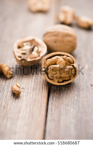 Walnuts on wooden table. Macro. Front view