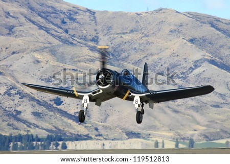 "WANAKA-MARCH 03: Corsair FG-1D aircraft takes off during the royal New Zealand air force 75th anniversary ""Warbirds Over Wanaka"" airshow on March 03, 2012 in Wanaka New Zealand"