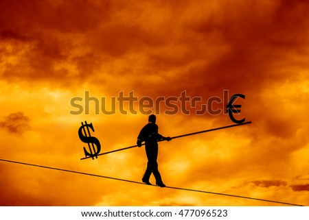 Wandering tightrope walker playing on yellow sky background. Silhouette of Equilibrist businessman with pole on the rope. Dollar and euro sign on two sides