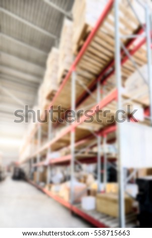 Warehouse of Commerce and Industry of transportation. Boxes and crates stocked on the shelves of three storey. Deep blur effect.