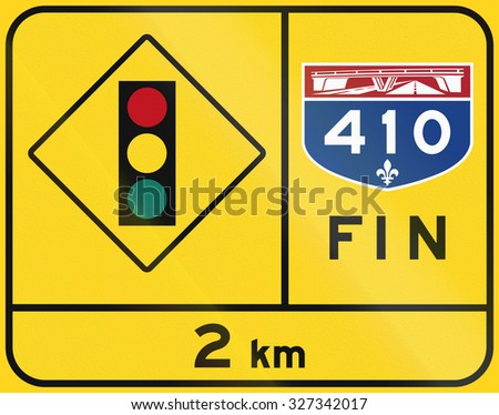 Warning road sign in Quebec, Canada - End of highway, Traffic lights. Fin means end