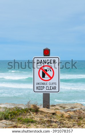Warning sign danger unstable cliffs keep clear rural coast line