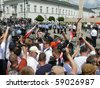 WARSAW - AUGUST 3: Protesters in front of Presidential Palace on August 3, 2010 in Warsaw, Poland. People fight to keep cross as symbol of mourning after president Kaczynski plane crash in April 2010 - stock photo