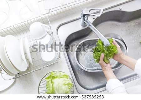 Wash the vegetables in the kitchen