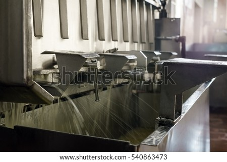 Washing of containers at milk production line