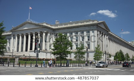 WASHINGTON, DC - MAY 2014: United States Treasury Department building, corner of 15th Street and Pennsylvania Avenue, next to the White House. Dept.of Treasury manages the U.S. government revenue.