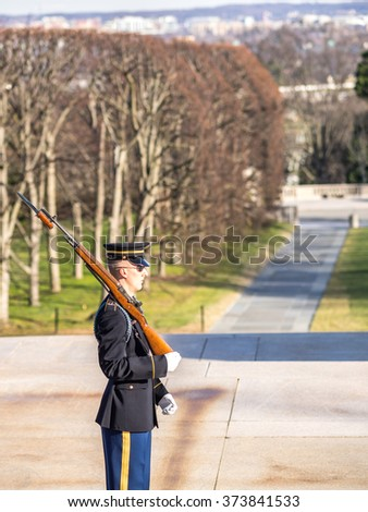 WASHINGTON DC, USA - DECEMBER 26, 2015: changing the guard at the grave of the unknown soldier at the cemetery of Arlington, Virginia