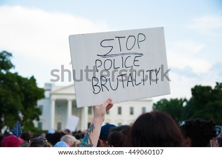 WASHINGTON JULY 7:  A sign held at a march against police brutality and racism in front of the White House in Washington, DC on July 7, 2016