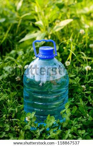 water bottle in a grass