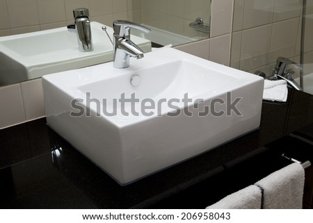 Water crane and white sink in a bathroom