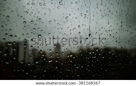 water drops on glass over the city