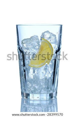 Water glass with ice & lemon isolated on white