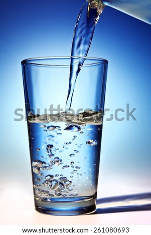 Water is being poured into a glass