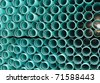 Water pipe stacked in a bundle. - stock photo