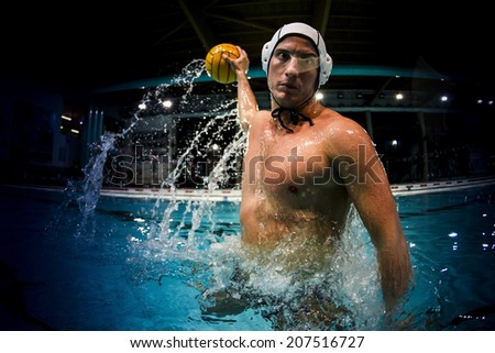 water polo player in swimming pool