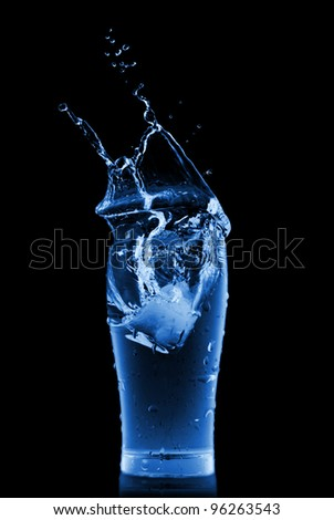 water splash in glass isolated on black