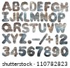 Watercolor alphabet with numbers stamped on rough textured crumpled paper, isolated. Made myself. - stock photo