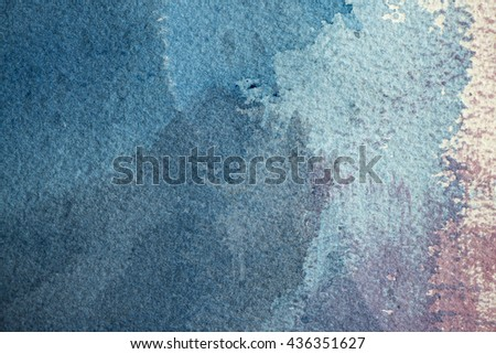 Watercolor paint on textured paper abstract background