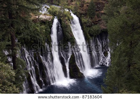 Waterfall: Evening above at the majestic 129 foot Burney Falls, located at McArthur Burney Falls Memorial State Park in Shasta County, California. Burney Creek flows from a natural spring.