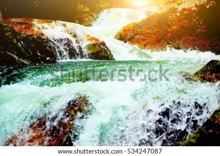 waterfall in forest at southern Thailand,waterfall in Thailand,select focus with shallow depth of field:ideal use for background.