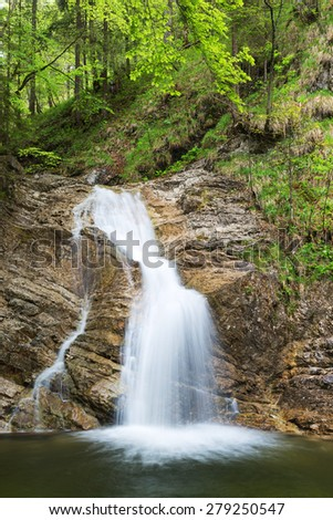Waterfall near Aschau im Chiemgau with fresh green leaves, Aschau, Bavaria, Germany