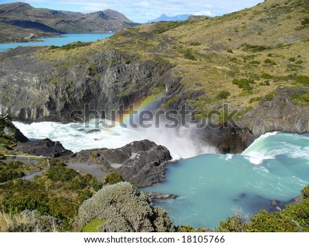 Waterfall with a rainbow in the Chilean Andes