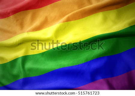 waving colorful gay rainbow flag.