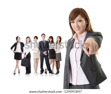 We want you, Asian business woman point at you in front of her team isolated on white background.