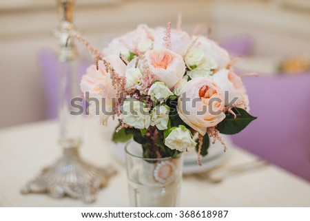 wedding bouquet in a vase on the table