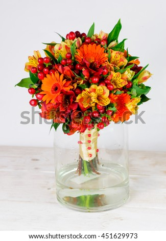 wedding bouquet in bright orange tones