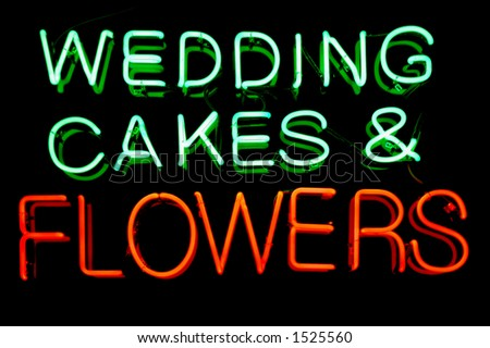 Wedding cakes and flowers neon sign
