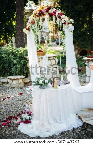 Wedding decoration on the marriage registration. Mounted on birch stumps, in a beautiful garden.